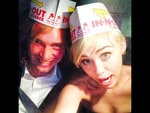 "Behind The Scenes 2014 MTV VMAs... Singer Miley Cyrus psts, ""me and my hero at in n out celebratin #myfriendsplace #mtvvmas2014"" Picture: Instagram"