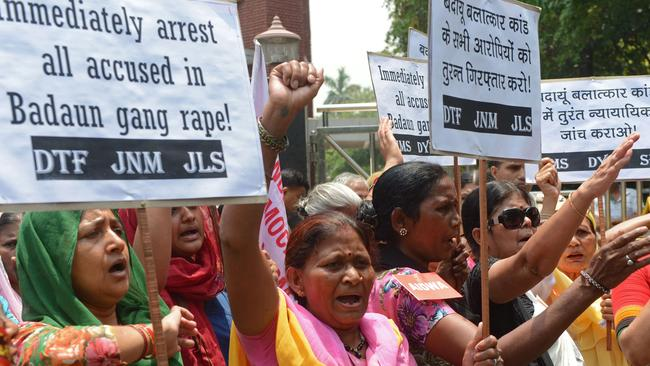 Furious ... feminist activists demand authorities track down the gang-rape suspects. Picture: AFP