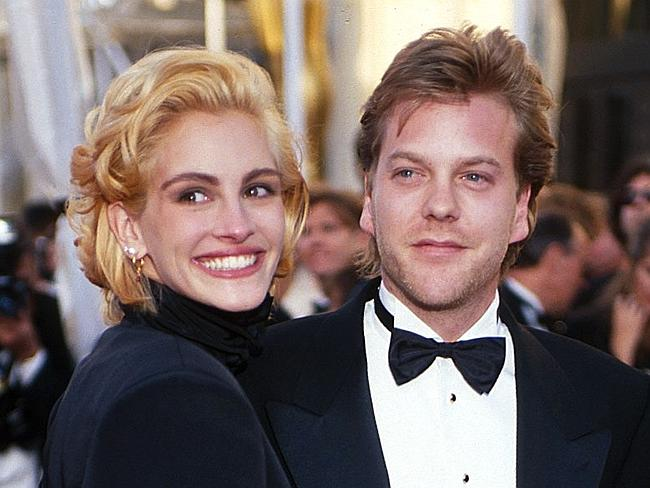 "JULIA ROBERTS & KIEFER SUTHERLAND: Long before Brad and Angelina, Hollywood power couples came no bigger than Kiefer and Julia. She was at the peak of her Pretty Woman fame; he was still riding high from the '80s ""Brat Pack"" thing and a couple of Young Guns movies. They met when starring together in the 1990 supernatural thriller Flatliners. They were to be married in a ""gala"" ceremony on a 20th Century Fox sound stage in June, 1991. But five days before the wedding, Roberts dumped Sutherland (reportedly after learning he'd cheated with a ""go-go dancer"") and ran off to Ireland with his best mate and Lost Boys co-star Jason Patric. While Roberts simply went on to more high-profile couplings and big movies, the split was pretty disastrous for Sutherland's career. It was 10 years before revived his fortunes with TV series 24. ""In fairness,"" he told the Evening Standard in 2002, ""you can't announce your plans to wed and court the media on the level we did, then call it off five days before it was supposed to happen and not expect a total tidal wave to knock you on your ass."" (Photo by KMazur/WireImage)"