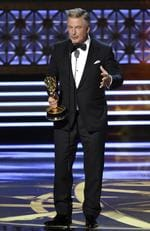 """Alec Baldwin accepts the award for outstanding supporting actor in a comedy series for """"Saturday Night Live"""" at the 69th Primetime Emmy Awards on Sunday, Sept. 17, 2017, at the Microsoft Theater in Los Angeles. Picture: AP"""