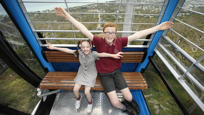 Arthurs Seat Eagle chairlift have invited schoolchildren and guests from around the Peninsula to be the first to ride the new chairlift. Peninsular Specialist College students Jaimee 7 and Lloyd 13 fly like an eagle while enjoying their ride and the view. Picture: David Caird
