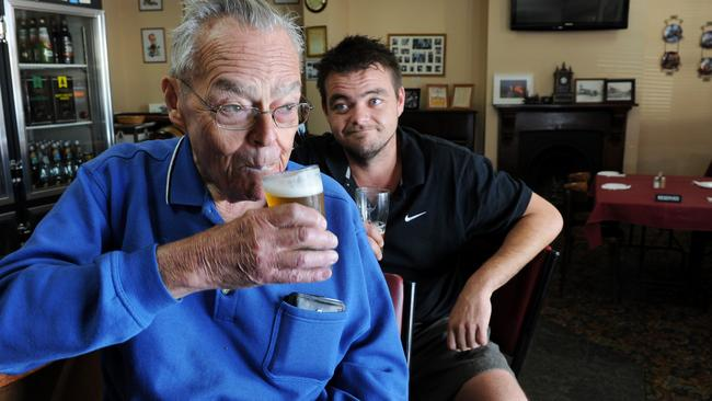 """Allan Brenton has a beer with grandson Clayton Revie at March's """"last drinks"""". Picture: Tricia Watkinson."""