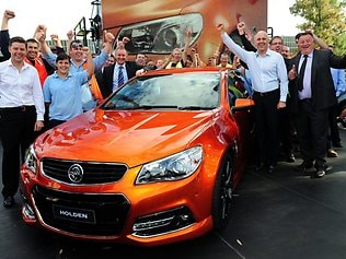 Holden workers, Premier Jay Weatherill and Holden's managing director Mike Devereux (right, in the white shirt) celebrate as Holden unveils its VF SS Commodore sports sedan to its workforce at Adelaide's Elizabeth plant. Picture: Mark Brake