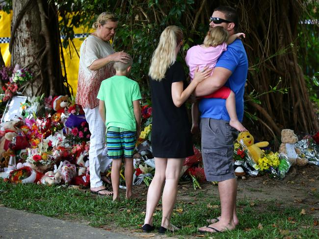 Families comforted each other near the house of horror.
