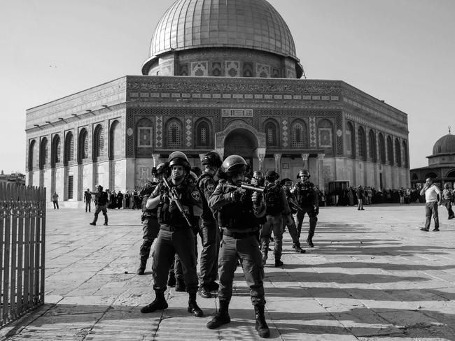 Israeli security forces hold position as they stand guard in front of the Dome of the Rock in the Haram al-Sharif compound in the old city of Jerusalem. Picture: AFP