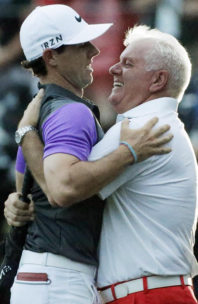 Rory McIlroy embraces his father Gerry after winning the PGA Championship.