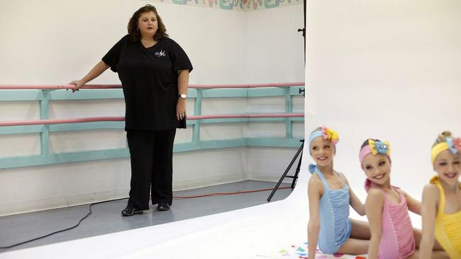 Dance coach Abby Lee Miller with tiny charges in reality TV show 'Dance Moms'.