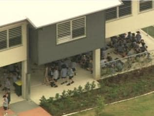 Two charged over school bomb threats
