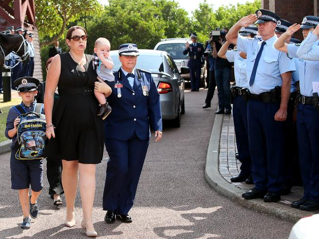 Margaret Richardson and sons Aiden 5 months and Patrick 7 are saluted by officers. Picture: Troy Snook