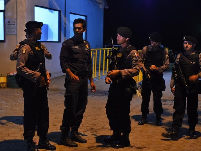 Execution site ... Armed police are seen at the port opposite Nusakambagan Island Prison near Cilicap, Java, Indonesia. Picture: Mick Tsikas/AAP