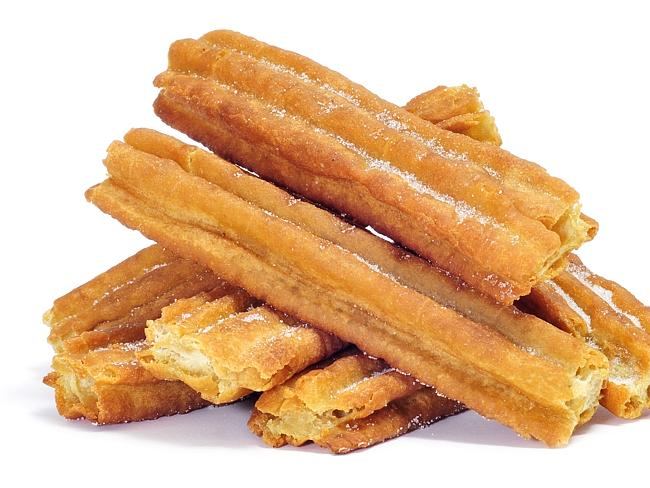 Churros are dipped in sugar and cinnamon.