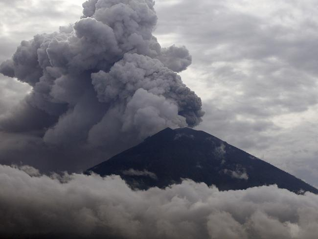 Clouds of ash rise from the Mount Agung volcano on Tuesday. Picture: AP/Firdia Lisnawati