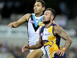 Round 5: Jarman Impey puts pressure on Eagle Chris Maston. Picture: Justin Benson-Cooper