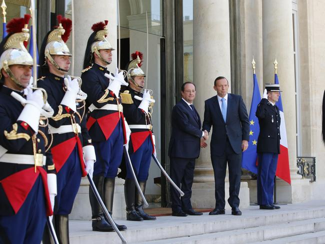D-day commemorations ... French President Francois Hollande poses with Prime Minister Tony Abbott prior to their meeting at the Elysee Palace in Paris. Picture: AP