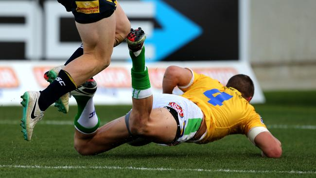 Jack Wighton crosses for one of Canberra's first tries against the Cowboys.