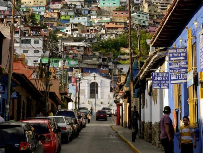 The colourful streets of Caracas look picturesque, but they hide a dark reality. Picture: Nick Farrell