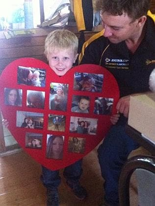Alexis Jeffery's son, Dawson, with a collage of photos of his mum (which hangs in his bed