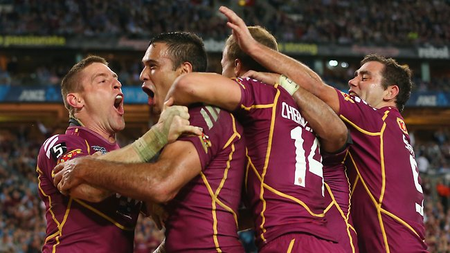 Justin Hodges celebrates a second half try with his Maroons teammates.