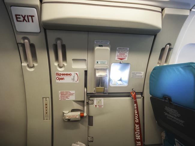 The plane's emergency exit door: great in an emergency, not great in a non-emergency.