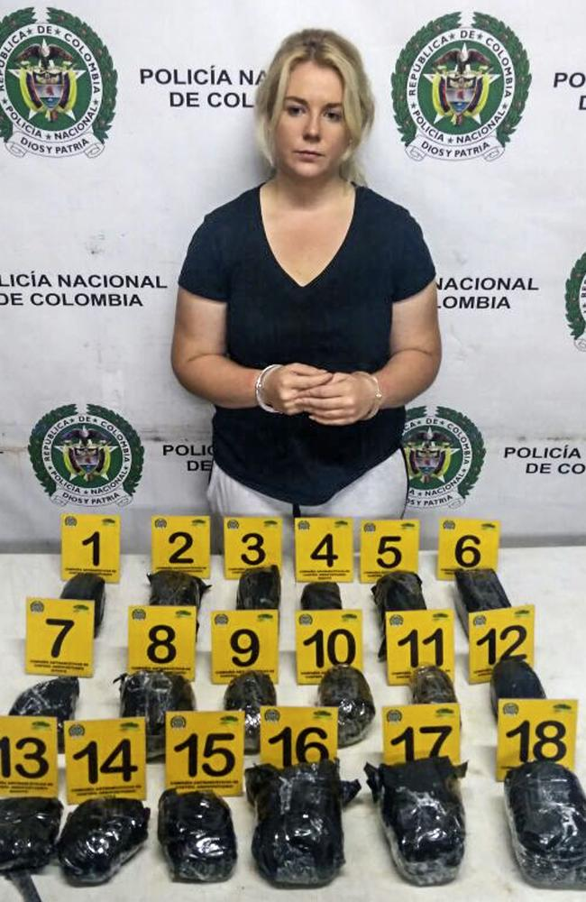 Cassandra Sainsbury with 18 packages police say contain cocaine. Picture: AFP Photo / Colombia's Antinarcotics Police