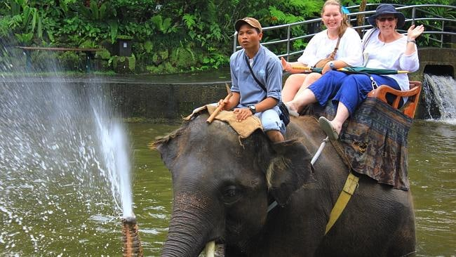 Noelene Bischoff and her daughter Yvana riding an elephant in Ubud.