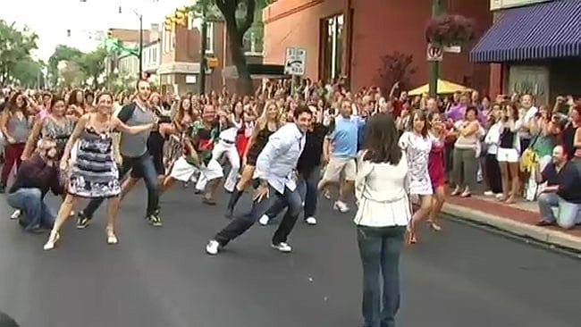Joey Lancianese organised for the street to be closed for his 300 person flash mob proposal to girlfriend Alex De Loia. Picture: YouTube