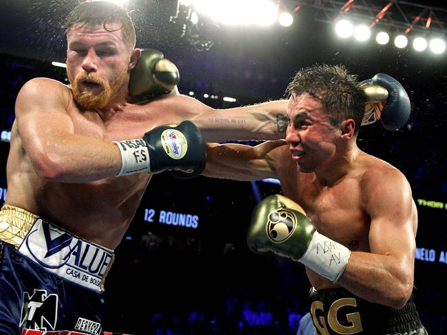 Canelo Alvarez (L) and Gennady Golovkin (R) battled to a controversial draw earlier this year.
