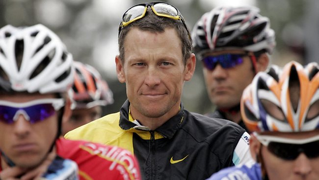 Lance Armstrong, center, smiles at the start of the final stage of the Tour of California cycling race in Rancho Bernardo, Calif., Sunday, Feb. 22, 2009. (AP Photo/Marcio Jose Sanchez)