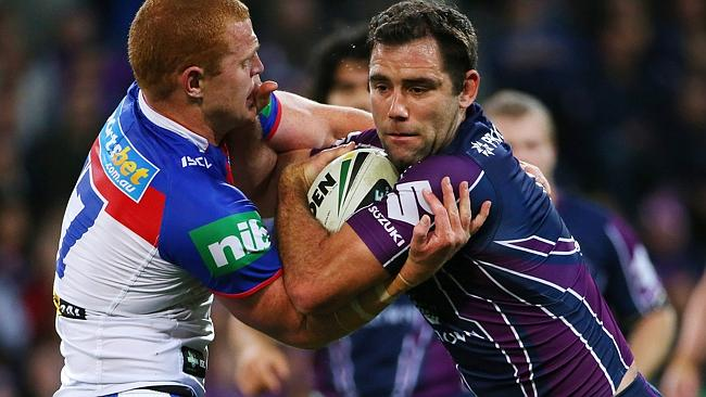 Cameron Smith is tackled during the semi final match against Melbourne Storm and Newcastle Knights.