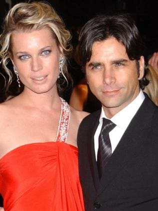 Ex-wife ... John Stamos and then wife Rebecca Romijn Stamos a year before they divorced. Picture: Supplied