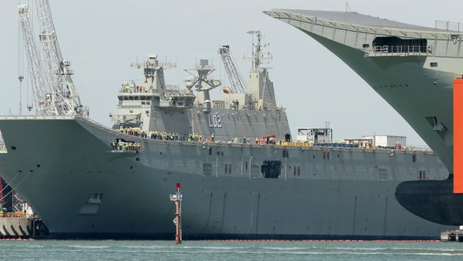 Serious errors ... workers at BAE Systems, Williamstown Dockyards fitting out the first of the Navy's Amphibious Assault Ships, HMAS Canberra.