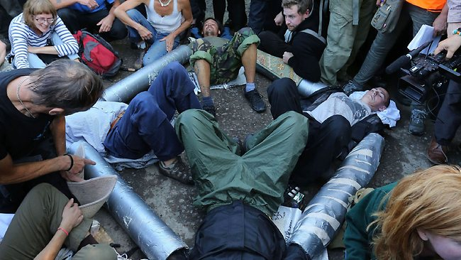 Activists lock themselves together at the main entrance to the Cuadrilla exploratory drilling site in Balcombe, England, as anti fracking demonstrations continue.
