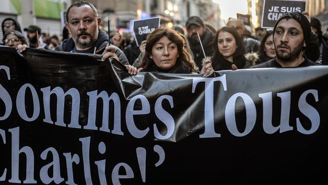 "Supporters ... Turkish journalists hold a banner which read: ""We all are Charlie"" as they march on Istiklal avenue to French consulate, in Istanbul during a rally they organised after the Paris attacks. Picture: AFP"