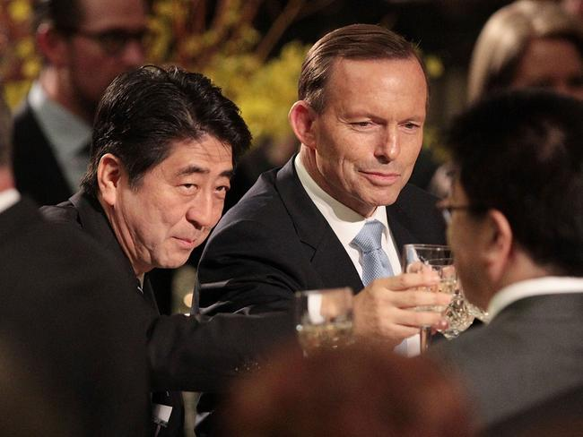 Cheers … Japanese Prime Minister Shinzo Abe and Tony Abbott toast after the two countries signed a historic free trade agreement. Picture: Stefan Postles/Getty Images