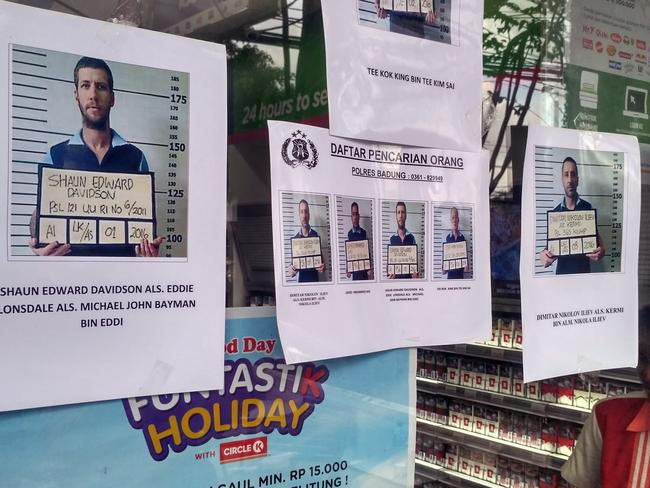Wanted posters in Bali after police forced the captured inmates to re-enact the dramatic escape. Picture: AAP Image/Putra Sinulingga