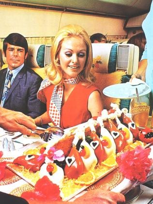 Dinner time on an Air New Zealand flight in the 1970s. Picture: Air New Zealand