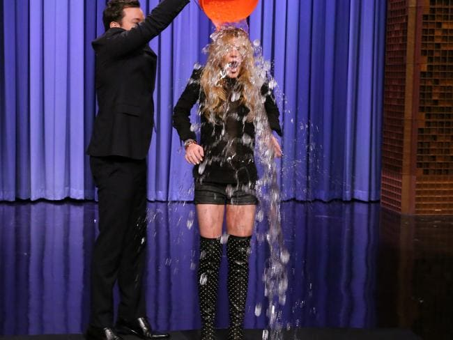 A worthy cause ... Jimmy Fallon, left, dumping a bucket of ice water over the head of actress Lindsay Lohan. Picture: AP