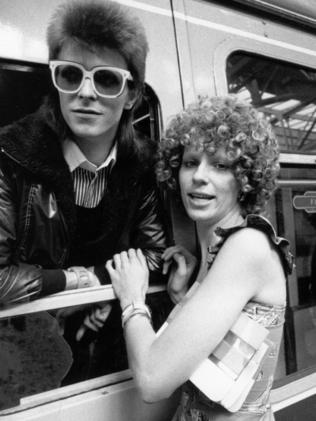 1973 ... David Bowie at a train station with his former wife Angie. Picture: Getty