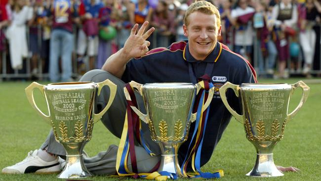Michael Voss with his three premiership cups.