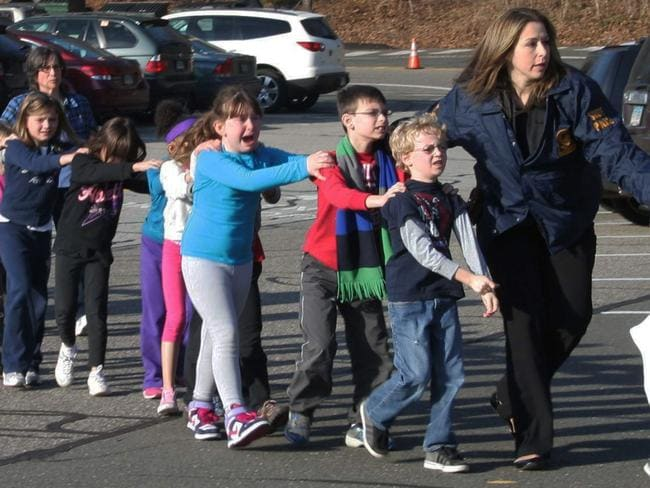 The Sandy Hook Elementary shooting in 2012 claimed the lives of 20 children and six adult staff members. Picture: AP/Newtown Bee/Shannon Hicks.