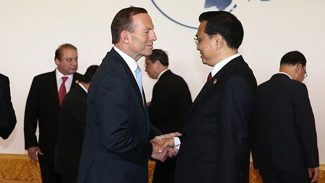 Global stage ... Prime Minister Tony Abbott greets China's Premier, Li Keqiang.