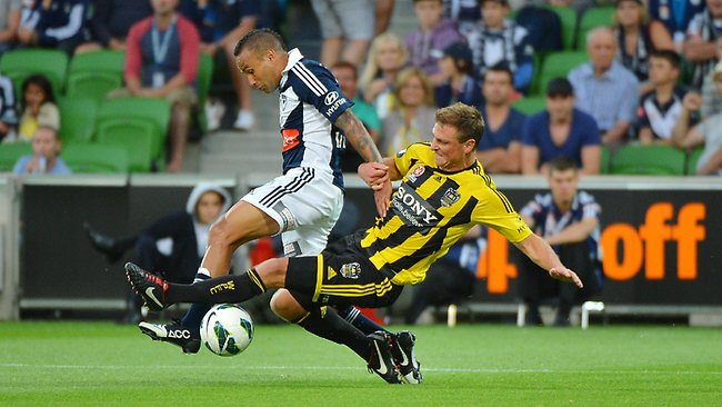 Melbourne Victory's Archie Thompson tackled in the first half by Ben Sigmund Picture: George Salpigtidis