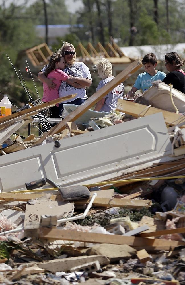 Residents and friends sift through debris after a tornado struck the area, Monday, April 28, 2014, in Vilonia, Arkansas. Picture: AP