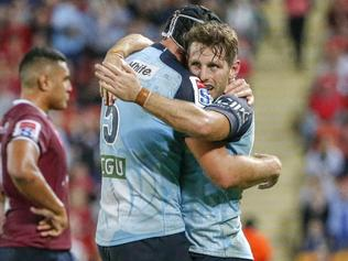Waratah players celebrate after their win during the Round 8 Super Rugby match between the Queensland Reds and the NSW Waratahs at Suncorp Stadium in Brisbane, Saturday, April 29, 2017. (AAP Image/Glenn Hunt) NO ARCHIVING, EDITORIAL USE ONLY