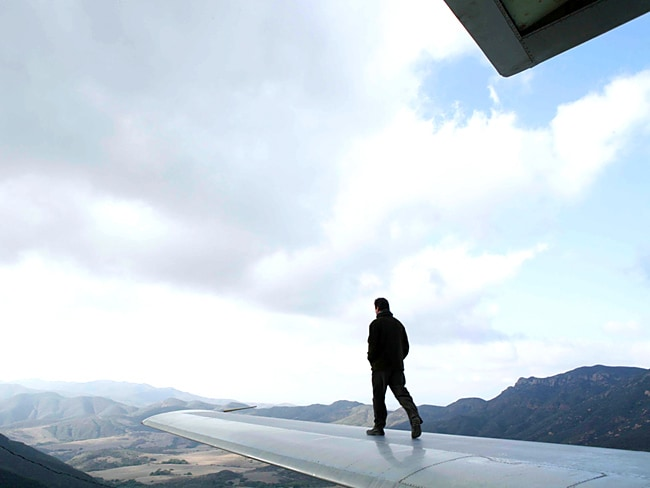 "A man walks on the roof of the Wing House. Picture:  <a href=""http://www.studioea.com/"">Studio of Environmental Archictecture</a>"