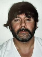 <p>A police handout released in 2007 shows Tony Mokbel, wearing a wig, after his arrest in the coastal Athens suburb of Glyfada. Picture: AFP</p>