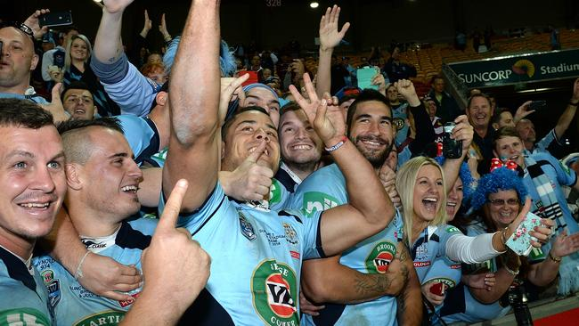 Greg Bird, Josh Reynolds, Jarryd Hayne and James Tamou of the Blues celebrate an Origin series victory with fans after game three of the State of Origin series between the Queensland Maroons and the New South Wales Blues.