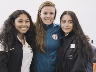 Melbourne City W-League champion midfielder Amy Jackson with students at the club's round-robin style talks. Picture: Supplied