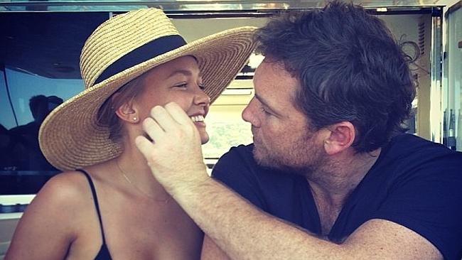 Sam Worthington, with girlfriend Bingle, may have been the one to curtail Lara's racy post. Picture: Instagram