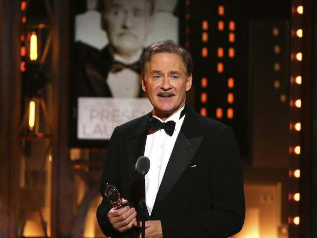 "Kevin Kline accepts the award for best performance by an actor in a leading role in a play for ""Present Laughter"" at the 71st annual Tony Awards. Picture: AP"